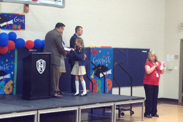 5th Grader receives certificate.