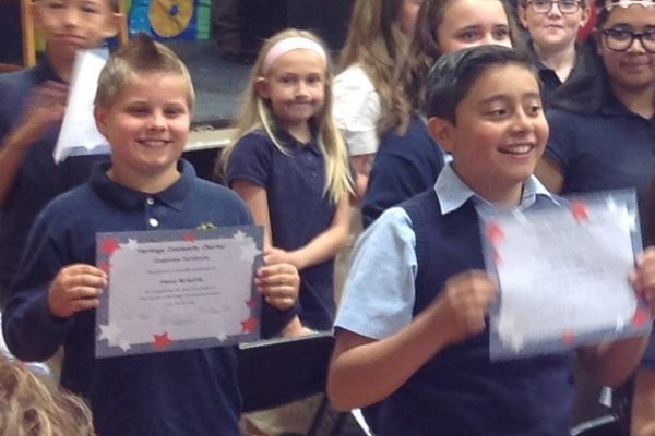 5th Grader with certificate.