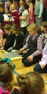 Children playing xylophones at the Christmas concert