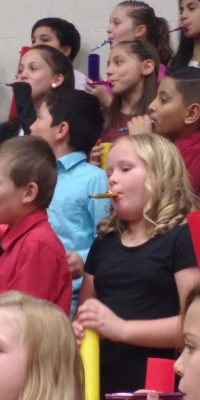 Children playing kazoos at the Christmas concert! It was amazing!
