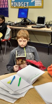Middle Schoolers enjoying books during Stop, Drop, & Read Day!